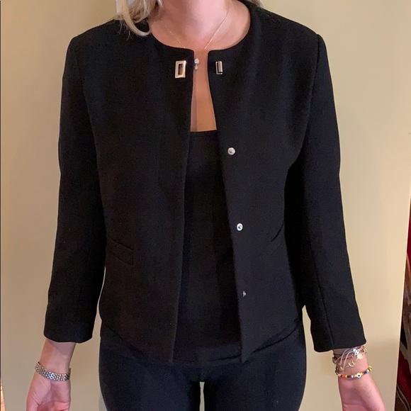 Short blazer with metal details. Never worn